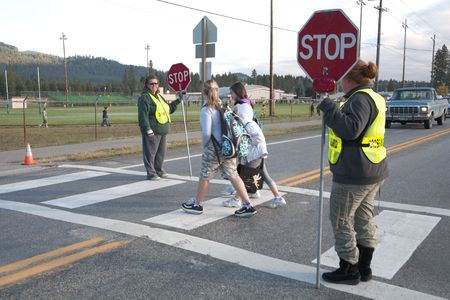 Rathdrum, Idaho. October 4, 2010. Unidentified crossing guard  stops traffic for kids crossing the street in Rathdrum Idaho on October 4, 2010.