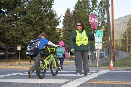 Rathdrum, Idaho. October 4, 2010. Unidentified crossing guard  stops traffic for kids crossing the street in Rathdrum Idaho on October 4, 2010. Stock Photo - 7959693