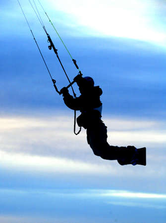 kiting: A man makes a jump while snow kiting.