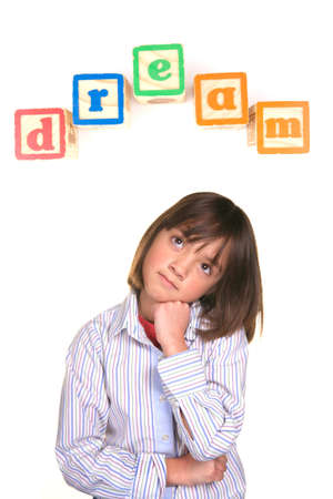 xyz: A young girl in a dreaming posture with the word dream above in blocks.
