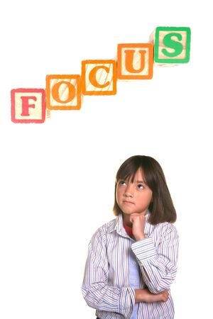 A young student strikes a focused posture with word block above.
