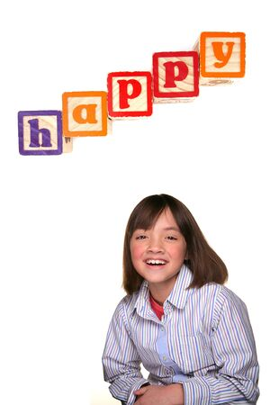 Young girl against white background smiling bic under the word happy.