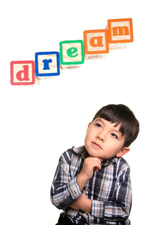 xyz: A young boy in a day dreaming pose under the word blocks.