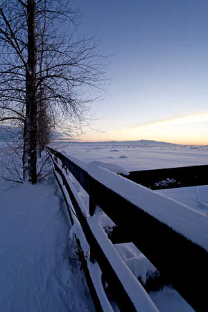 A snow covered fence on the Rathdrum Prairie in northern Idaho. Stock Photo - 8555474