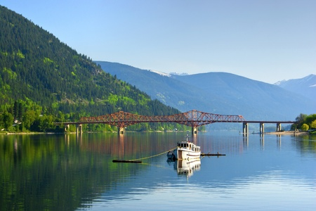 A small fishing boat moored on the west arm of Kootenay Lake.