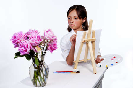 Looking at the flowers to paint. Stock Photo - 9753554
