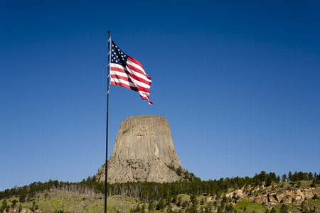 flag pole: An American flag waves near the entrance to Devils Tower park in Wyoming.