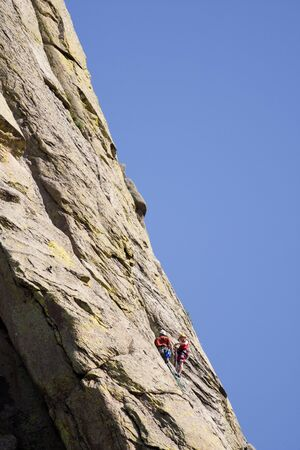 Rock climbers climb up the side of Devils Tower in Wyoming. photo
