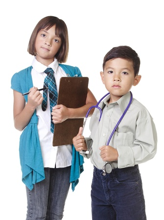 Two young kids in a concept image of future careers. Stock Photo - 10471993