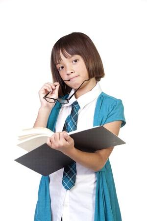 contemplates: Girl contemplates about a book. Stock Photo
