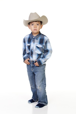 A young boy plays dress up in cowboy outfit. Stock Photo - 10471990