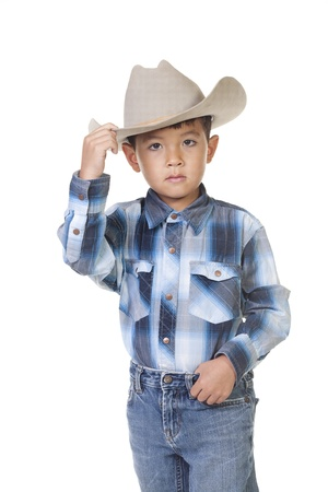 A little boy in cowboy outfit shows his best tip of the hat. Stock Photo - 10472002