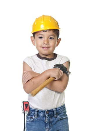 A young boy dresses up in construction cloths with some tools. Stock Photo - 10472000