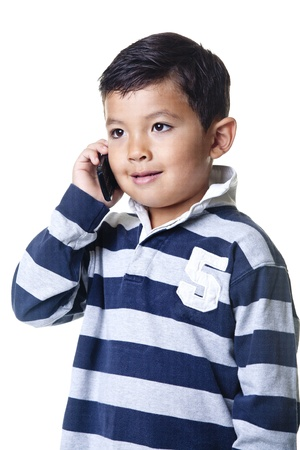 A young boy talks on the cellphone. Stock Photo - 10472004