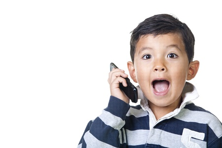 A young boy shows a surprised reaction with the cell phone. Stock Photo - 10471995
