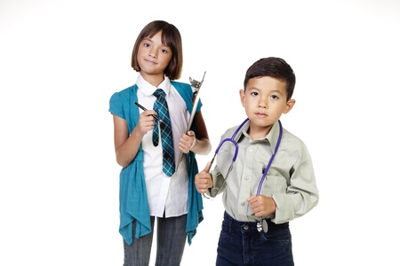Two young kids in a concept image of future careers. photo