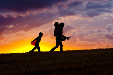 Mother carries daughter. Stock Photo - 10741301