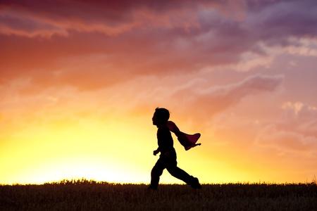 cape: Little boy runs along.