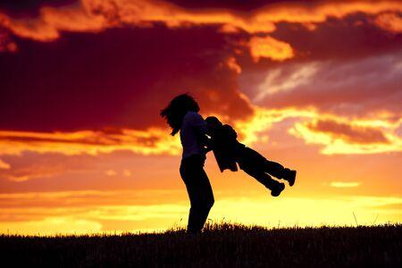 Swinging her son around. Stock Photo - 10741177