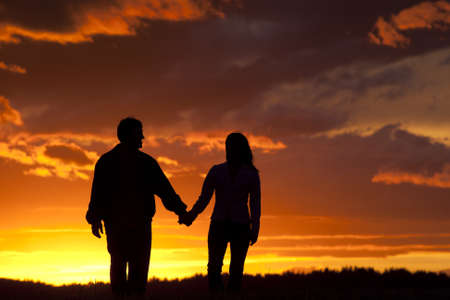 A couple at sunset share a romantic moment. Stock Photo - 10741168