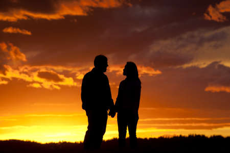 Romantic couple at sunset. Stock Photo - 10741169