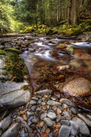 boulder rock: The rapid movement of a swift mountain stream. Stock Photo