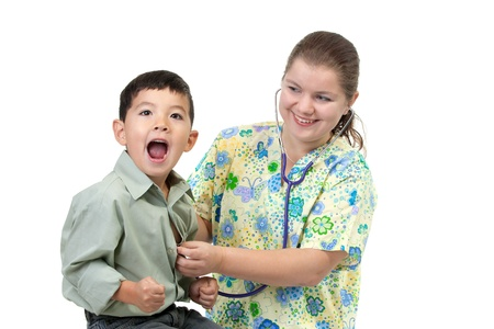 reacts: Boy reacts to cold stethoscope.  Stock Photo