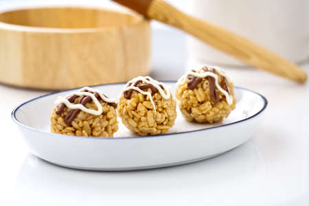 Chocolate covered crisp treats.  photo