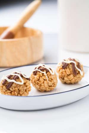Three chocolate covered treats. photo
