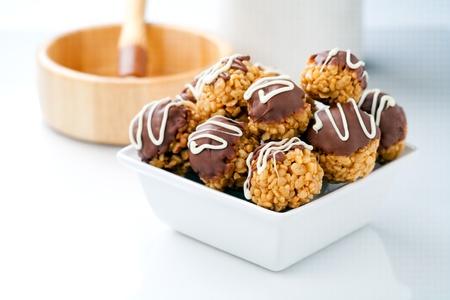 Bowl of chocolate crisp rice treats  photo