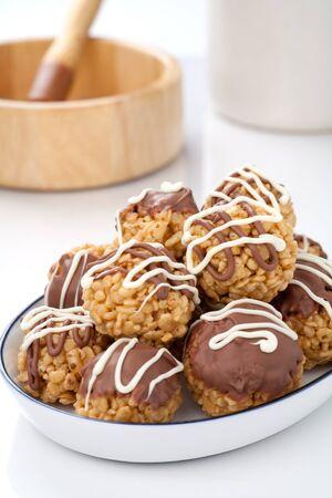 Chocolate covered crispy treats.  photo