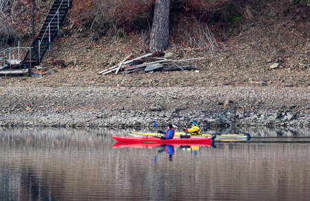 A husband and wife kayak on a seasonably warmer day on January 2, 2012 in Beauty Bay on Lake Coeur d