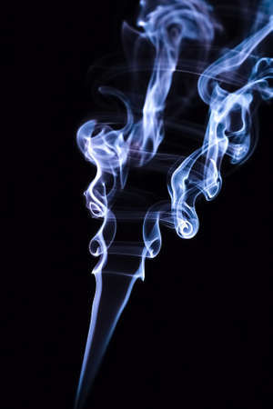 Blue smoke spirals.