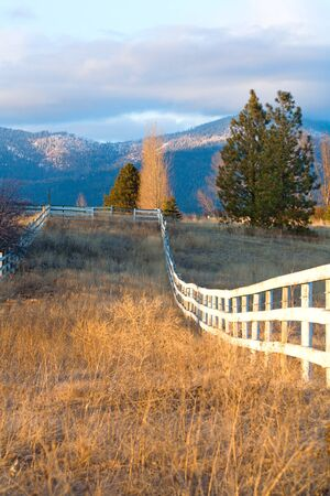 Wooden fence in a rural scene. Stock Photo - 12436714
