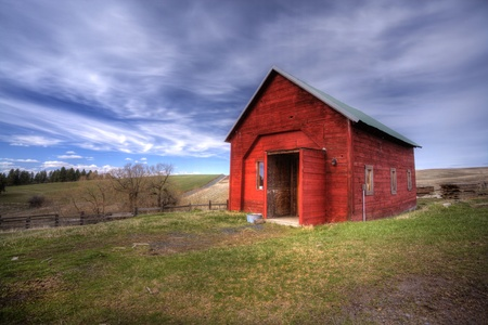 Red shed, green grass, blue sky