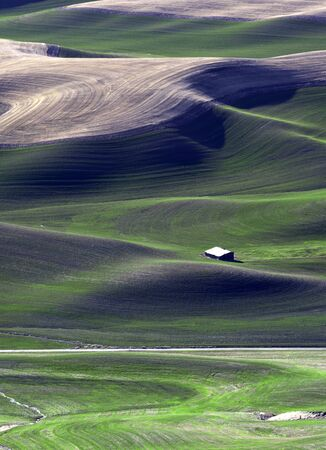 palouse: Building dwarfed by the Palouse.  Stock Photo