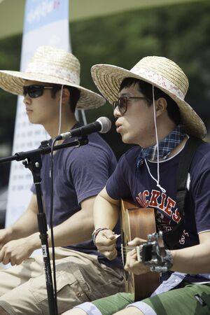July 9, 2012 - Seoul, Korea. Two Korean men perform their music outdoors in downtown, Seoul, Korea.