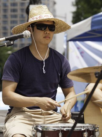 July 9, 2012 - Seoul, Korea. A Korean man performs music outdoors in downtown, Seoul, Korea.