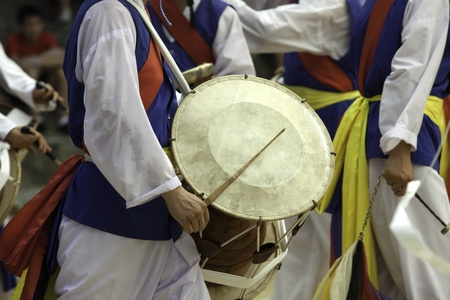 A traditional Korean drummer keeps the beat at the Korean Folk Village in Yongin, Korea  photo