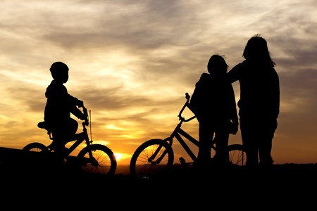 Mom and kids bond at sunset  Stock Photo - 15584881