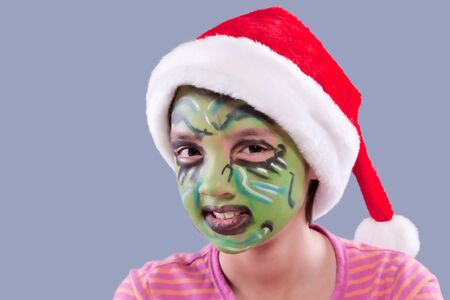 Funny face paint and Santa hat   photo