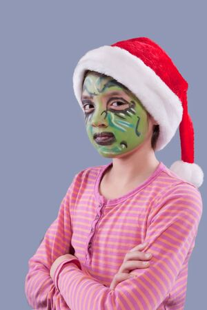 Girl with grinch like face paint   photo