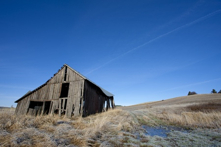 An old rustic barn in a farm field north of Potlach, Idaho. Stock Photo - 16821613