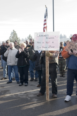 amendment: Coeur dAlene, Idaho - January 19, 2013. Unidentified man holds a sign during the pro 2nd amendment rally in Coeur dAlene, Idaho to peacefully protest the gun control legislation. Editorial
