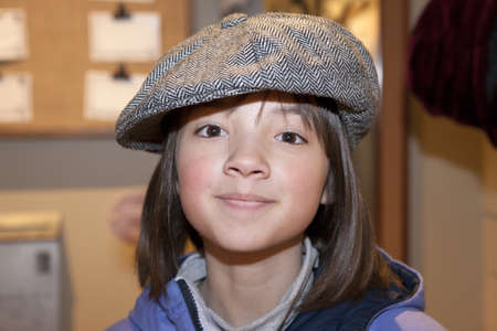 Girl wears old hat  photo