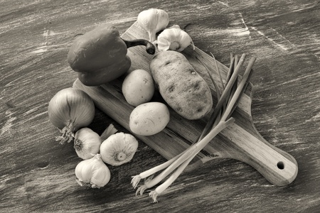 b w: B W of veggies and cutting board  Stock Photo
