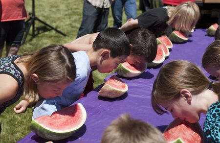 Kids compete in a watermelon eating contest at the Rathdrum Days in Rathdrum, Idaho on July 21, 2013