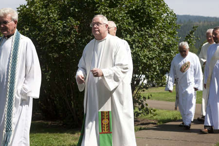 feast: Jesuit Priests walk to the start of the feast of assumption at Cataldo, Idaho on August 15, 2013