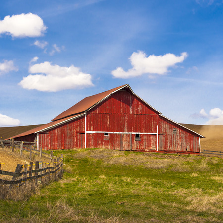 countryside landscape:  Red barn and blue sky  Stock Photo