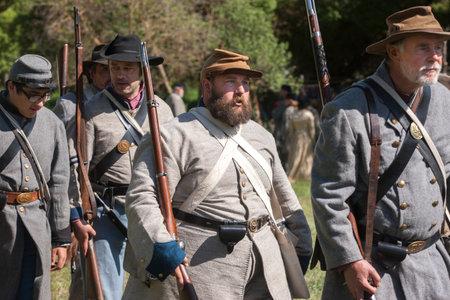 Confederate reenactors on the march  Medical Lake, Washington USA - May 24, 2014  Civil war reenactment of Deep creek battle near Medical Lake, Washington on May 24, 2014